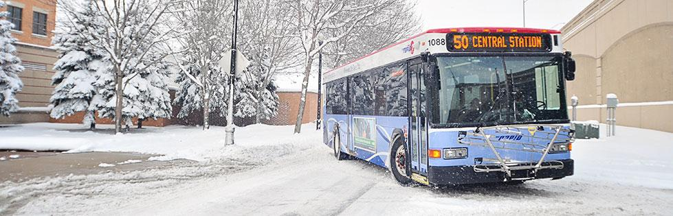 Route 50 bus in snow - Pew Campus